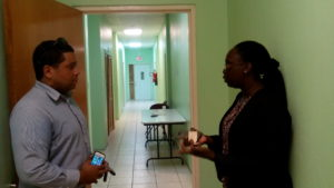 Andrew Skerrit, PS in the Office of the Prime Minister discusses recommendations for NEOC activation with Dep. NDC, Claricia Langley-Stevens